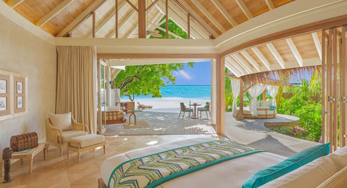 Beach villa bedroom with views onto the beach