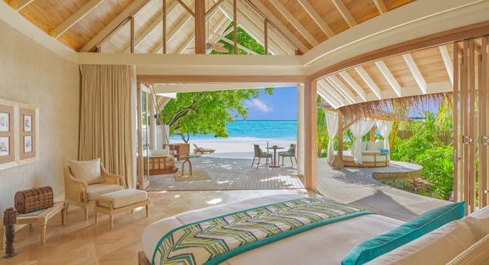 Beach villa bedroom with views onto the beach