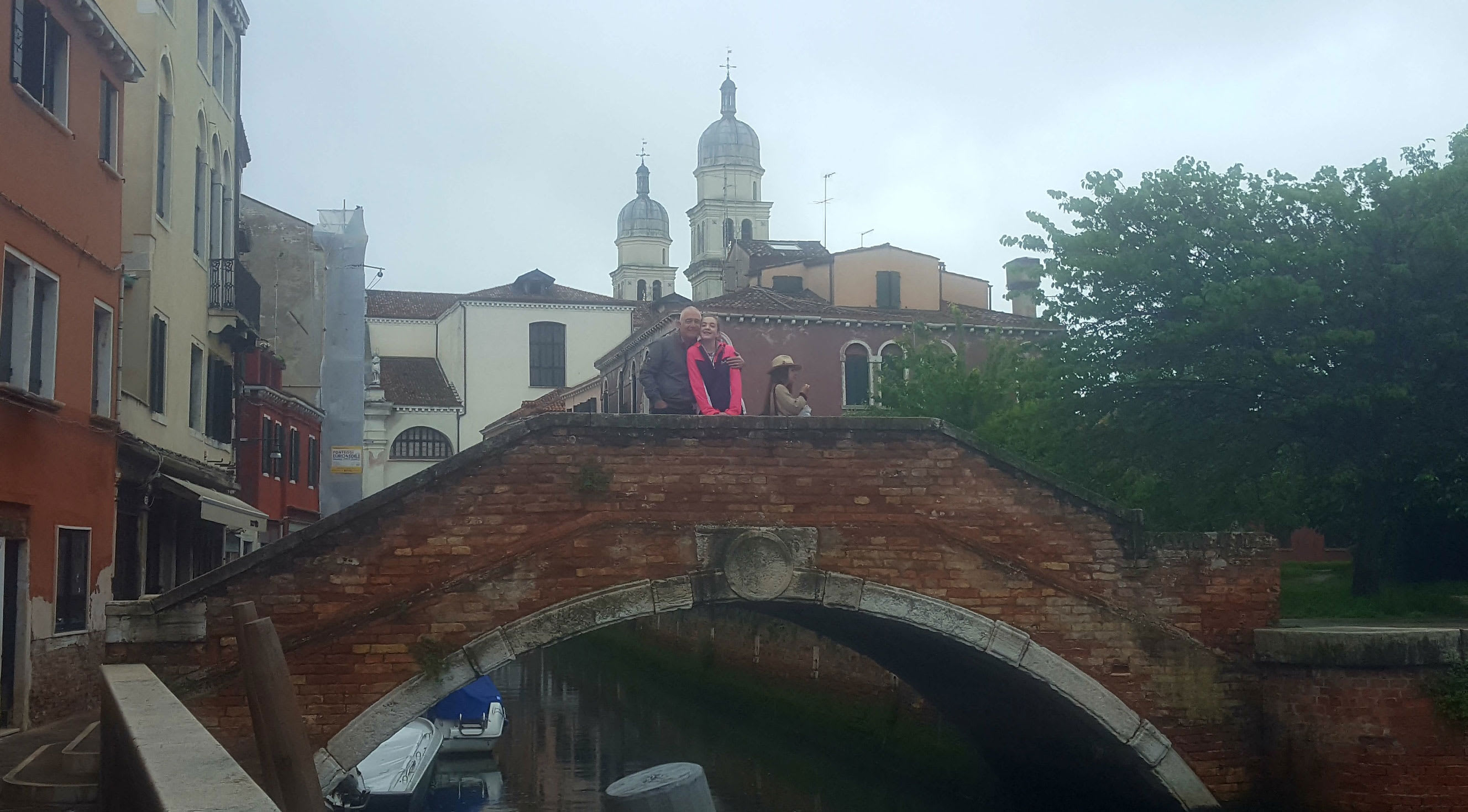 Fater and daughter on bridge in Venice