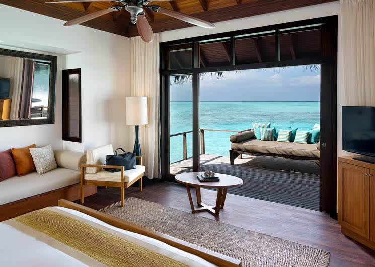 Overwater bungalow room and deck