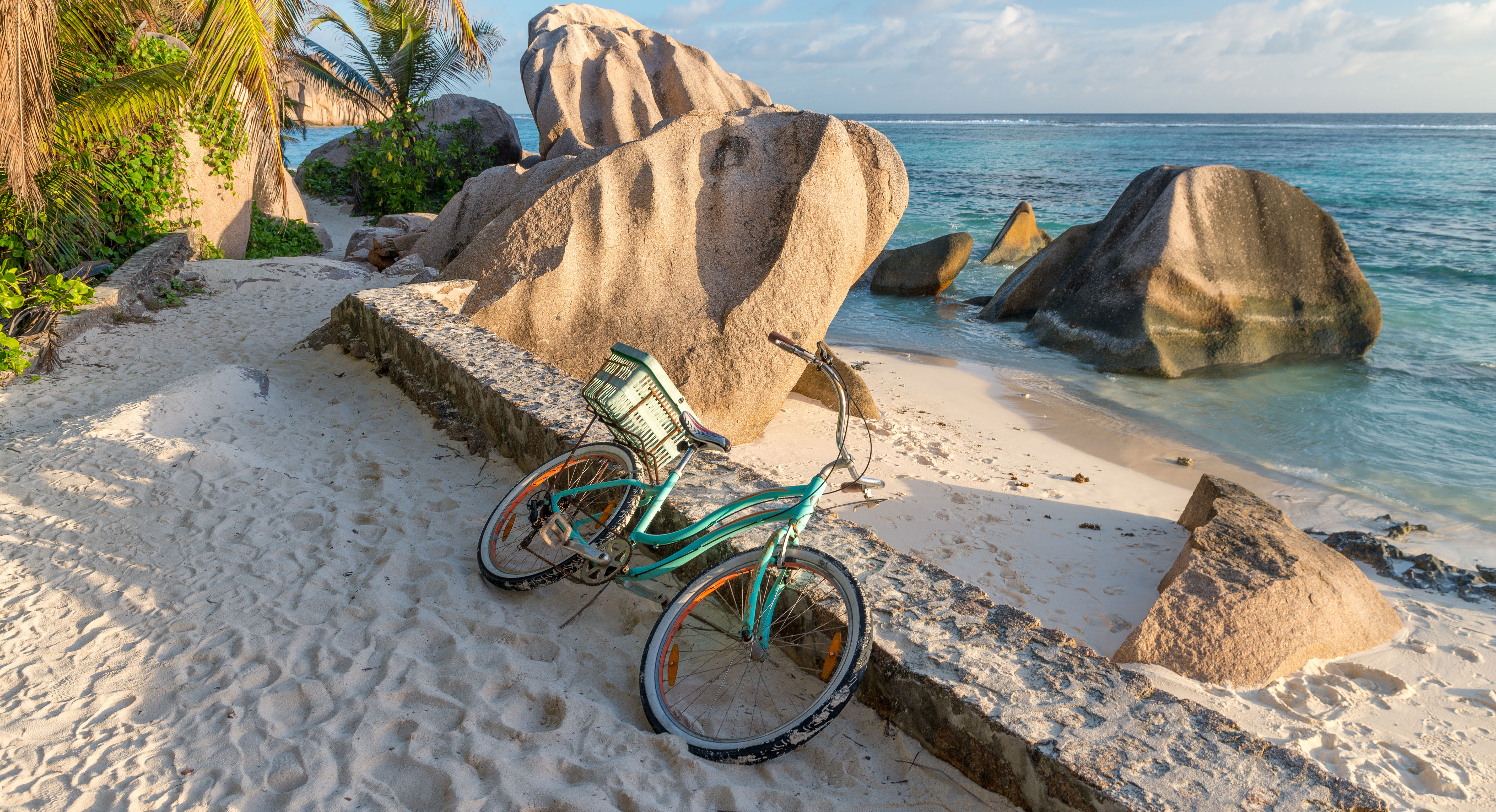 La Digue beach with blue bike