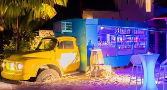 Blue and yellow food truck at night