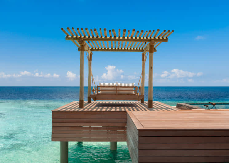 Reef and Overwater Villa   swing bed