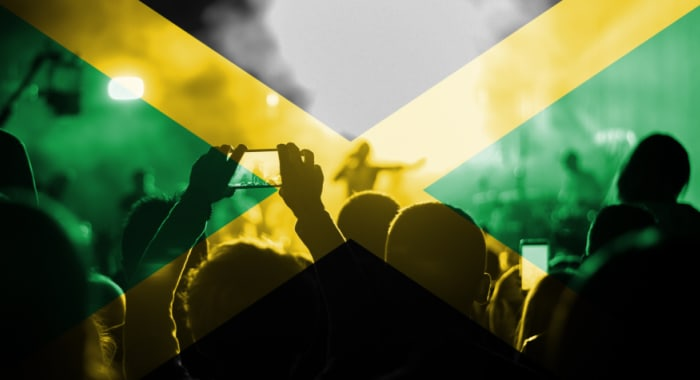 People dancing on stilts in the street wearing colourful costumes