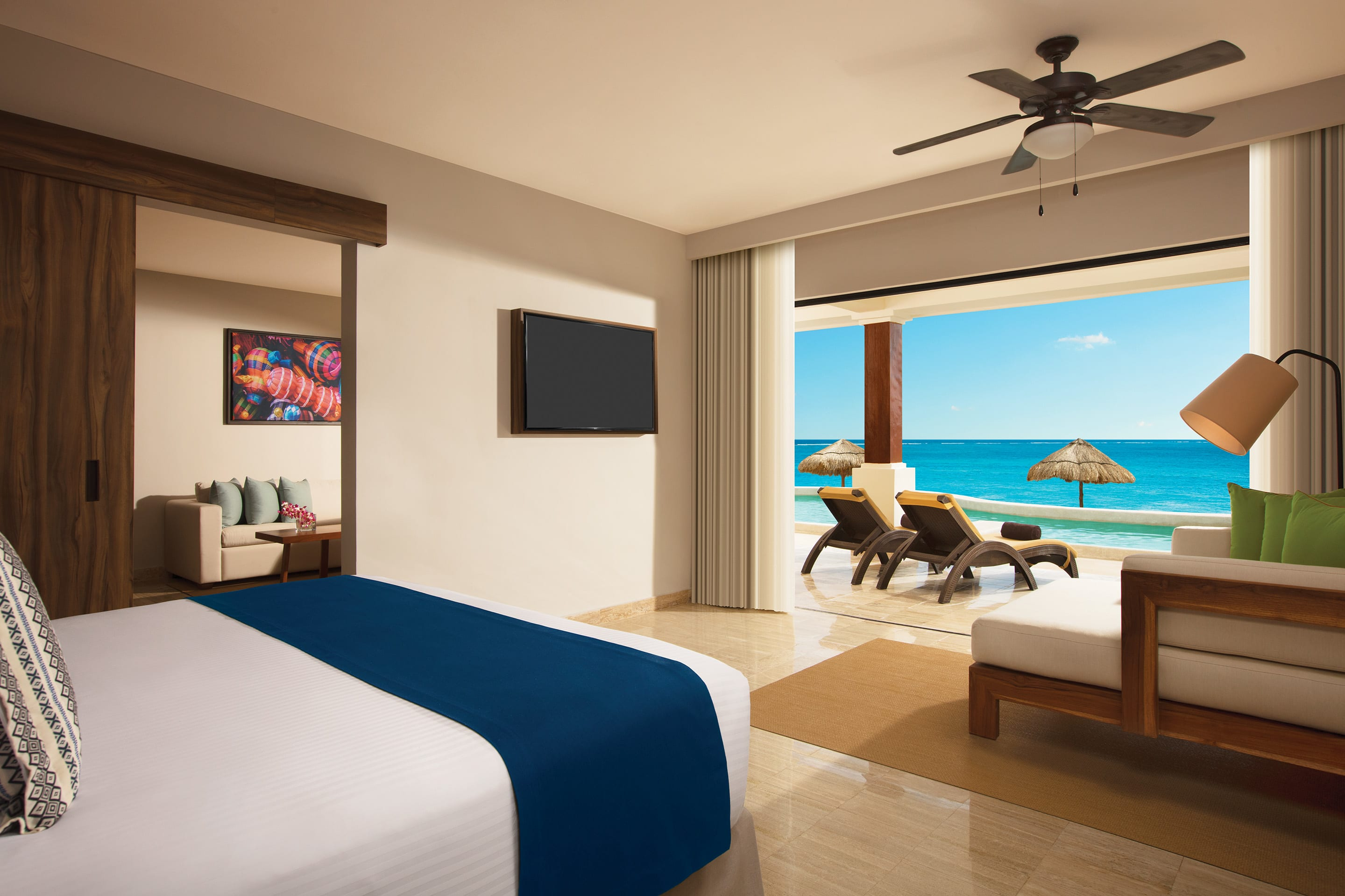 Preferred Club Junior Suite Beach Front Swim Out Bedroom