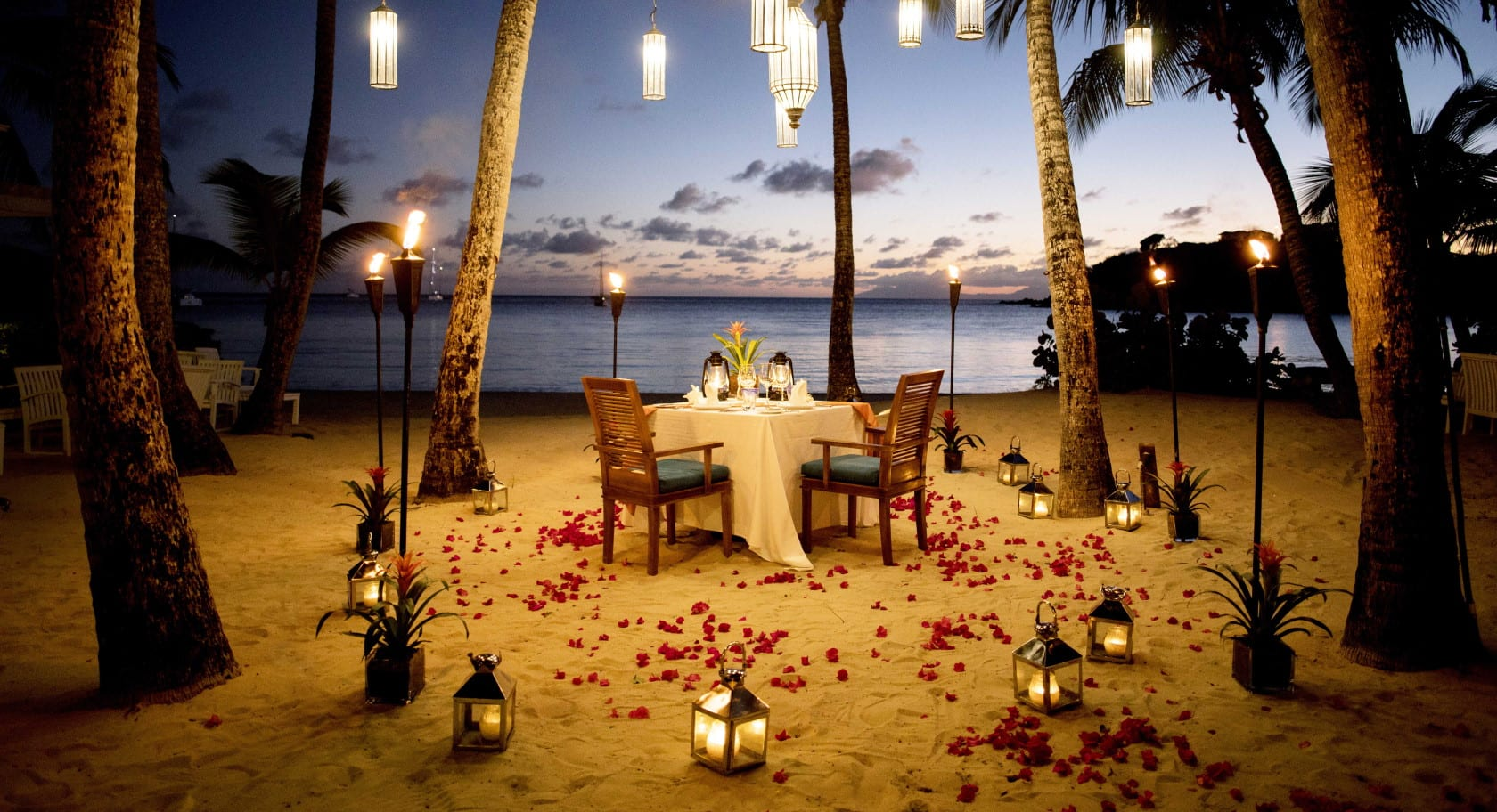 Romantic private dining area on the beach at night