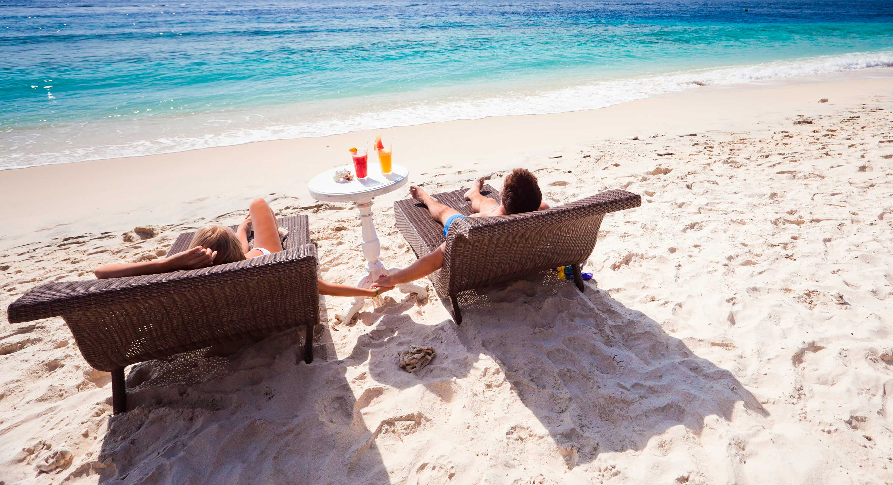 A couple realxing on sunbeds on the beach