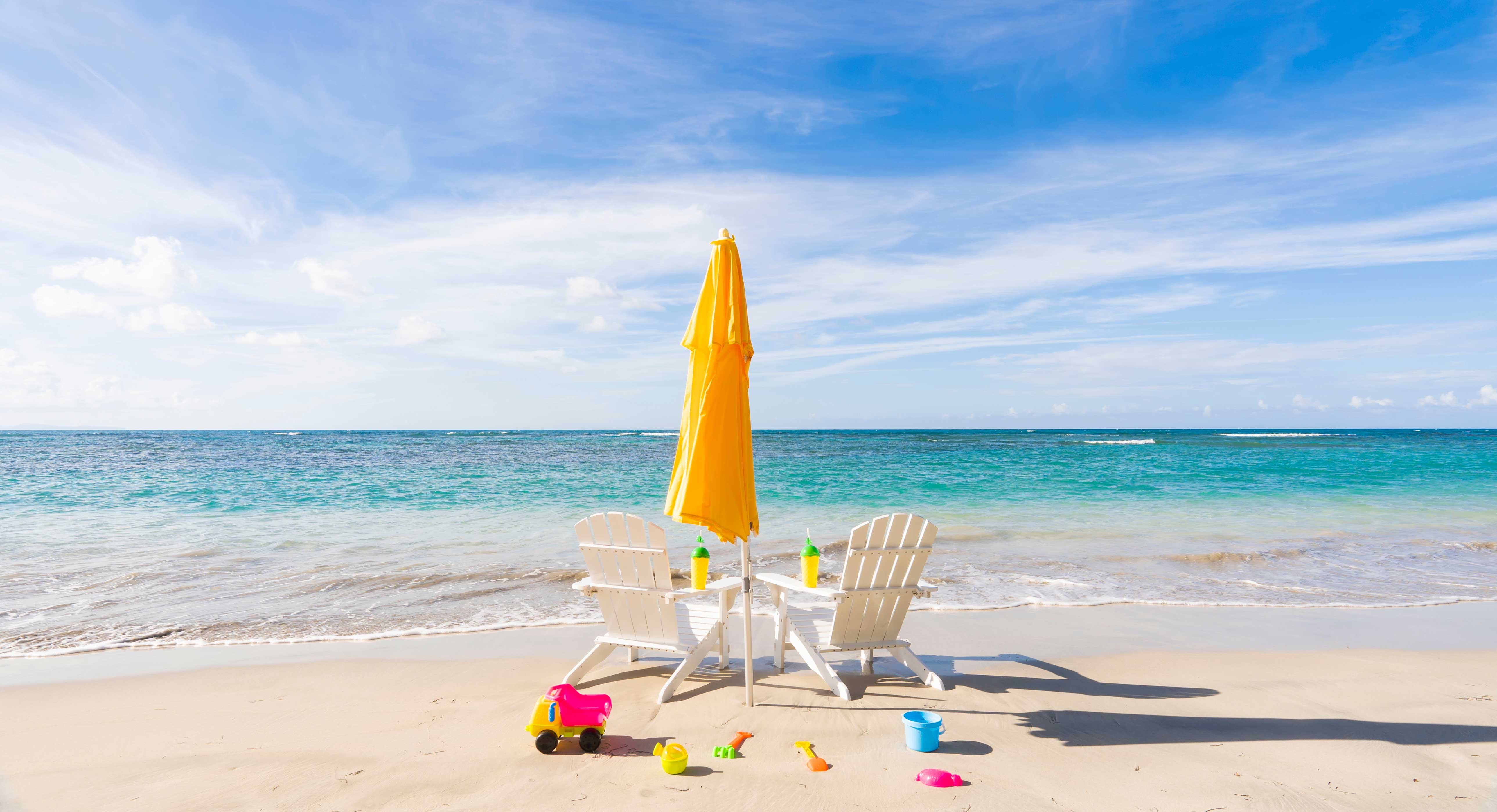 Sunbed and parasol on beach