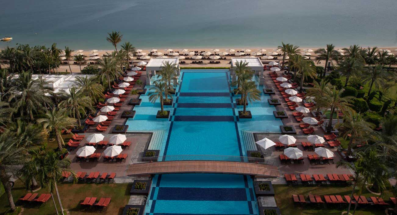 Jumeirah Zabeel Saray. aerial view of swimming pool sea and beach