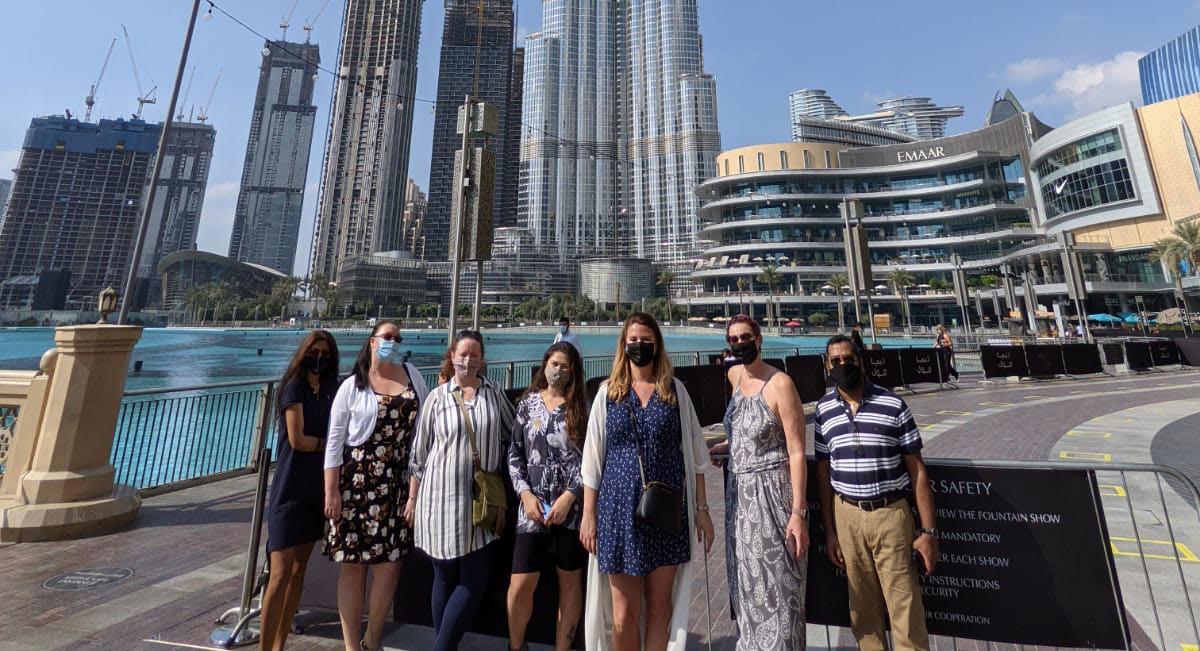 Gruop photo at marina in Dubai wwearing masks