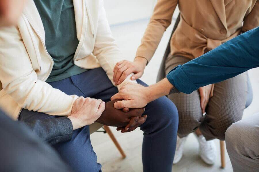 Peer Support Group Holding Hands.
