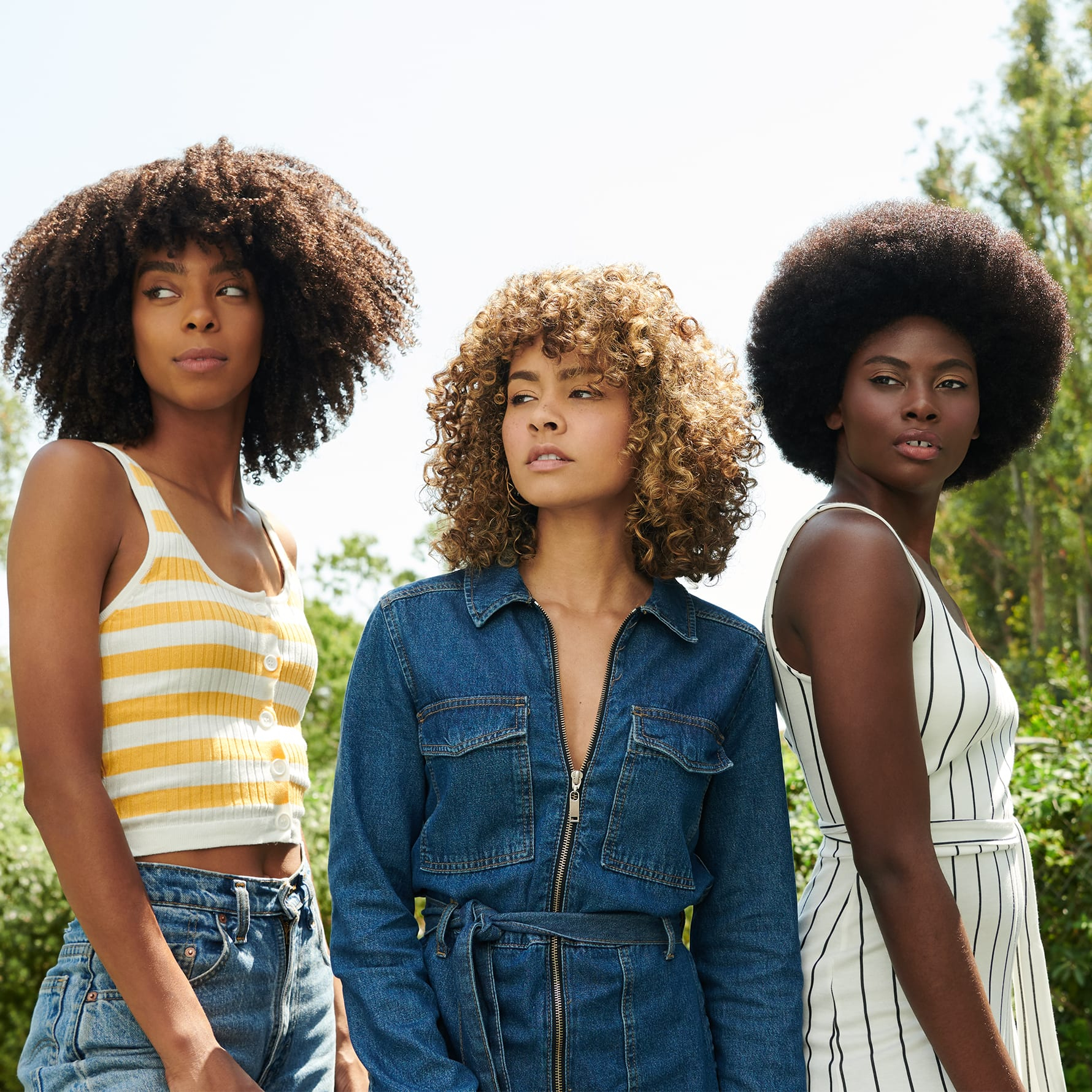 three women with curly hair hanging out