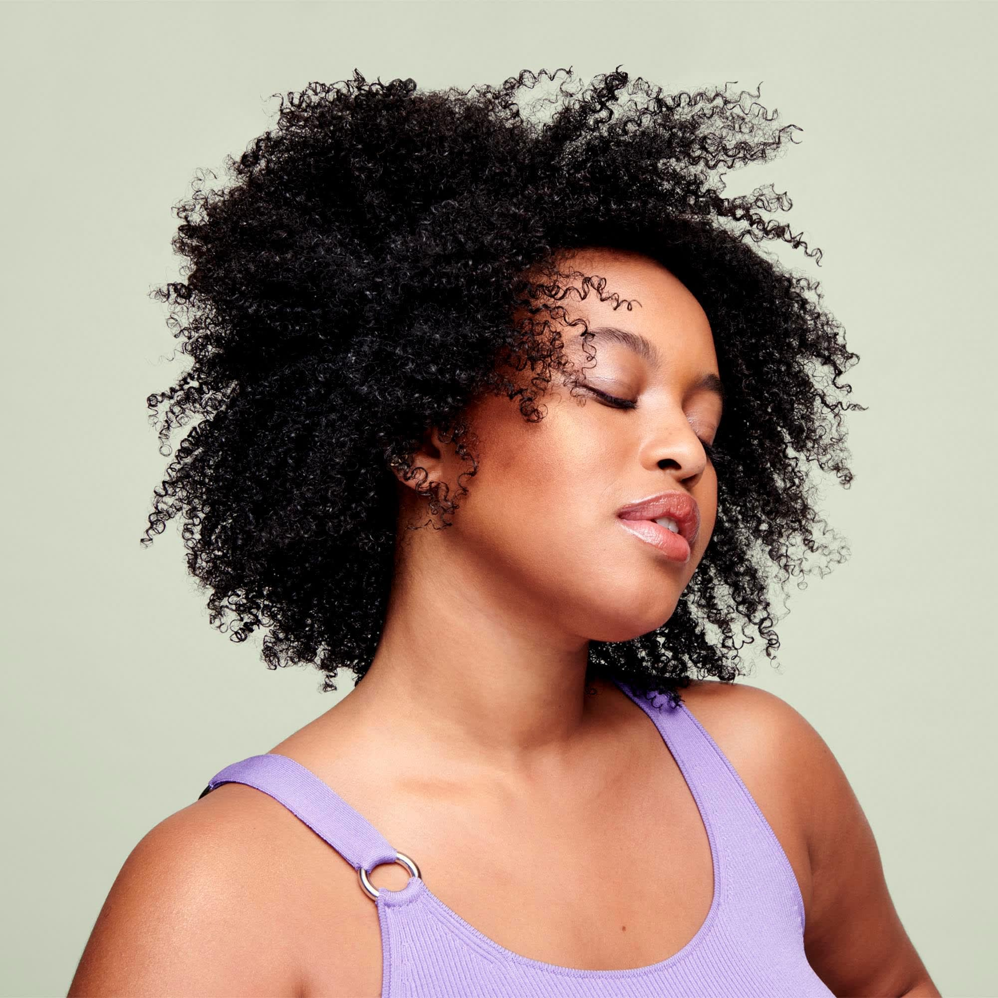 Woman with coarse coily curls