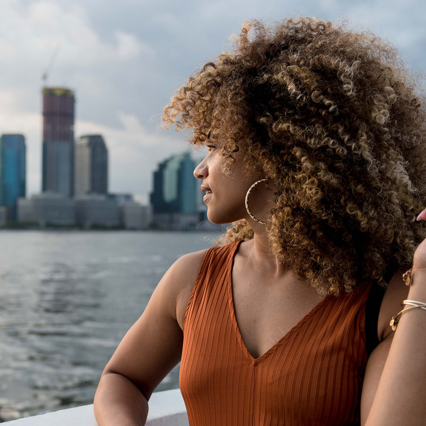 Super curly hair woman overlooking the city