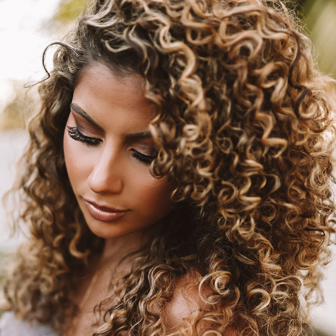 woman with highlighted blonde curls