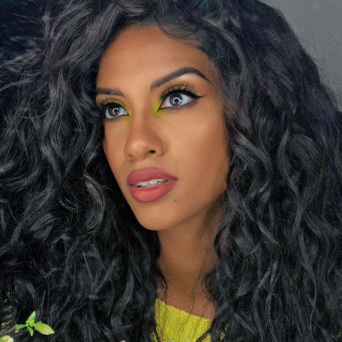 woman with long dark brown wavy hair