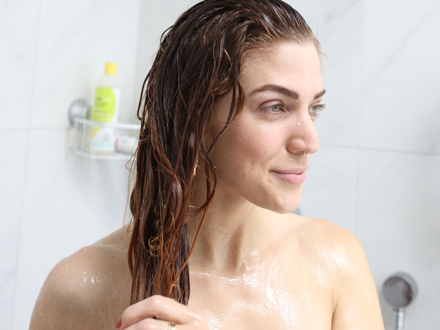 woman in the shower with wet red wavy hair