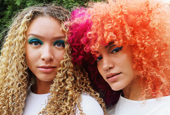 two girls curly hair