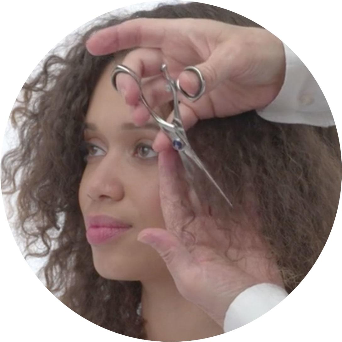 woman with curly hair getting a deva cut