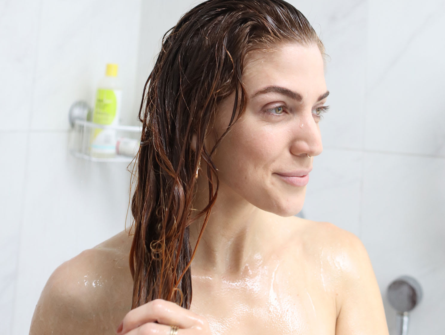 woman in shower with wet red hair