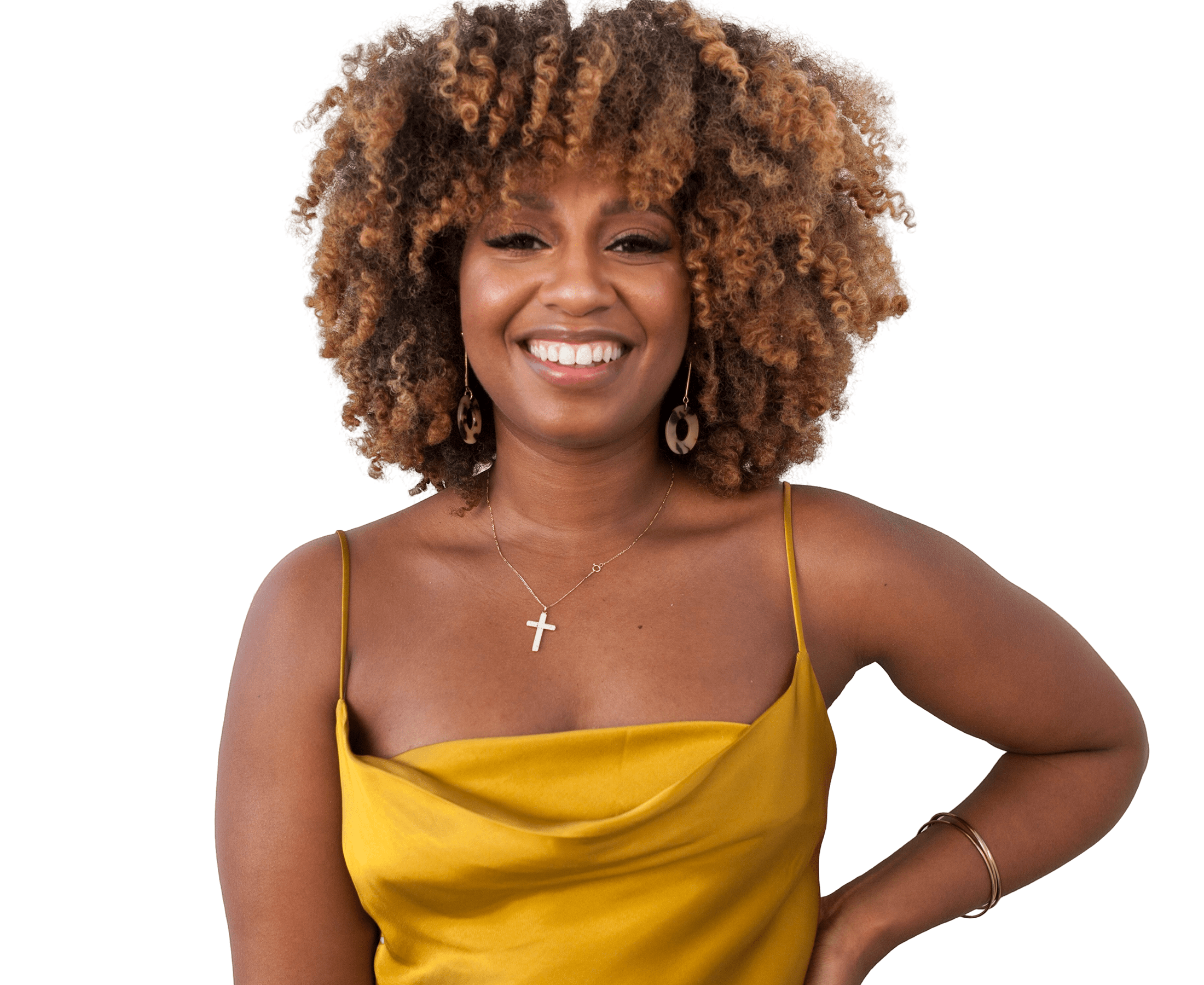 Woman smiling with short highlighted curly hair