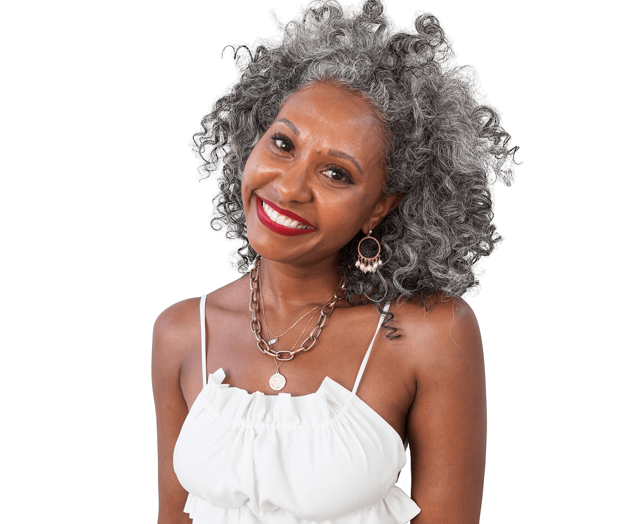 Woman smiling with silver curly hair