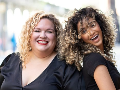 curly stylist and curly client smiling