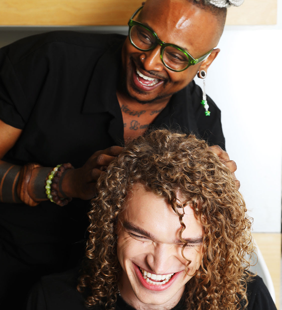 hair stylist fluffing curly hair
