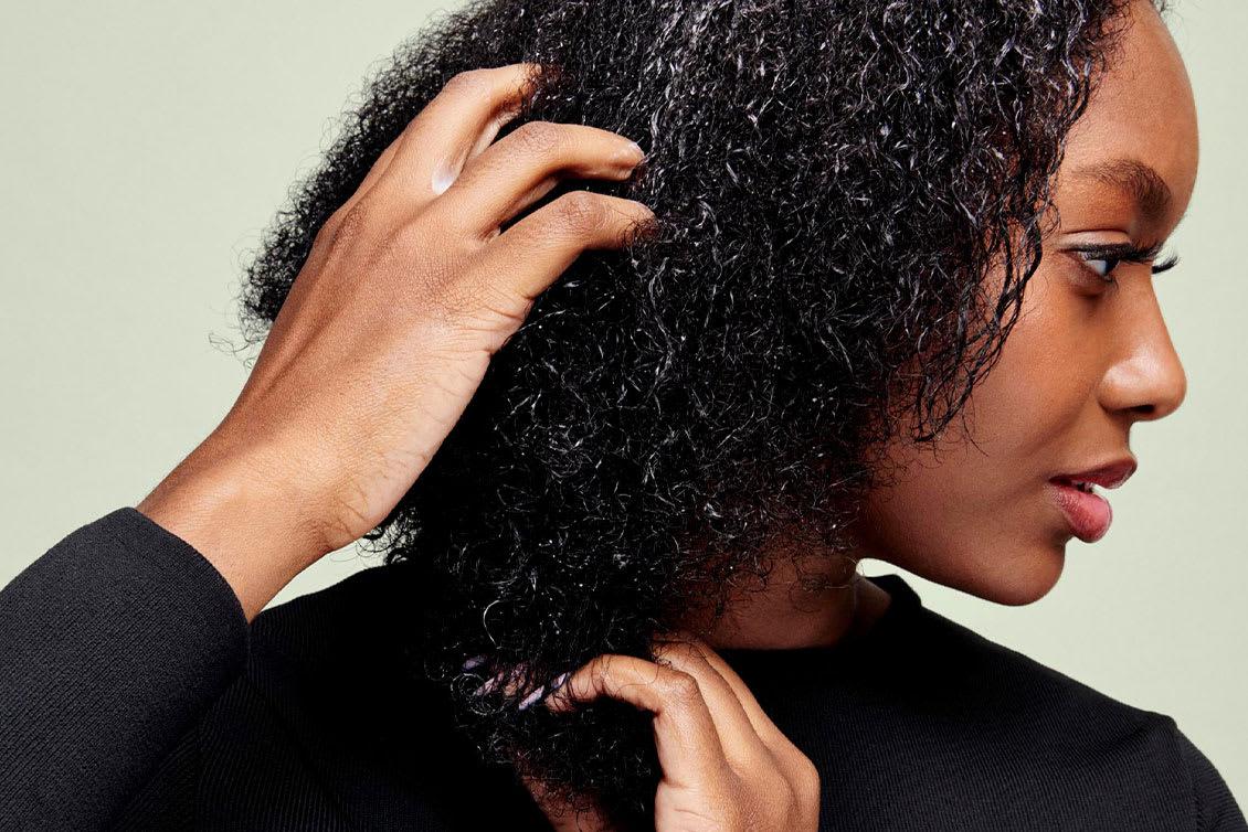 hands combing through hair