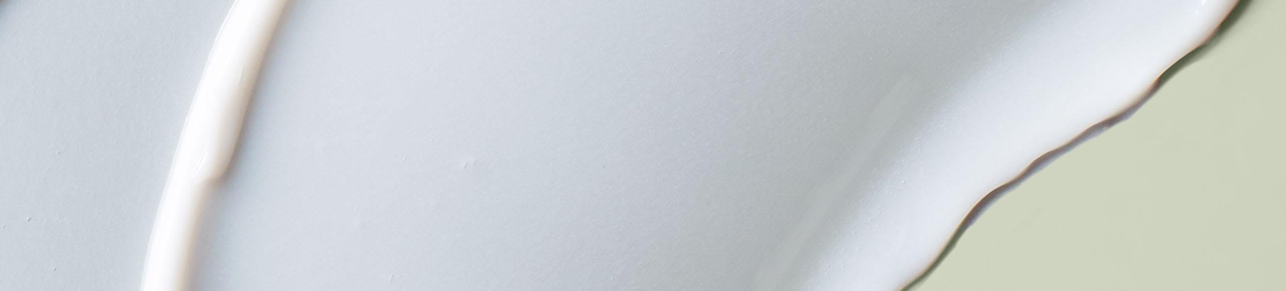 white goop on plain sage background