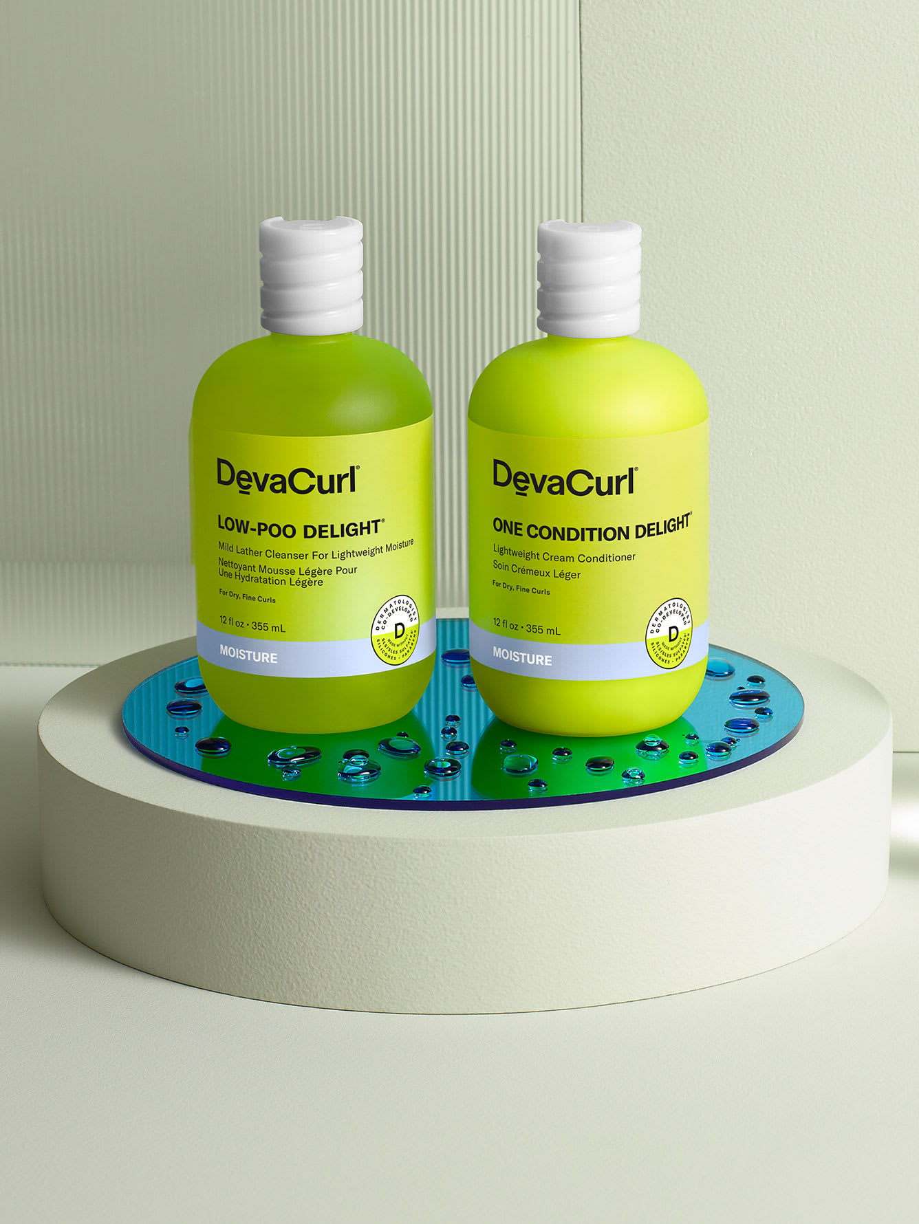 product laydown of DevaCurl Delight cleanser and conditioner with ingredients
