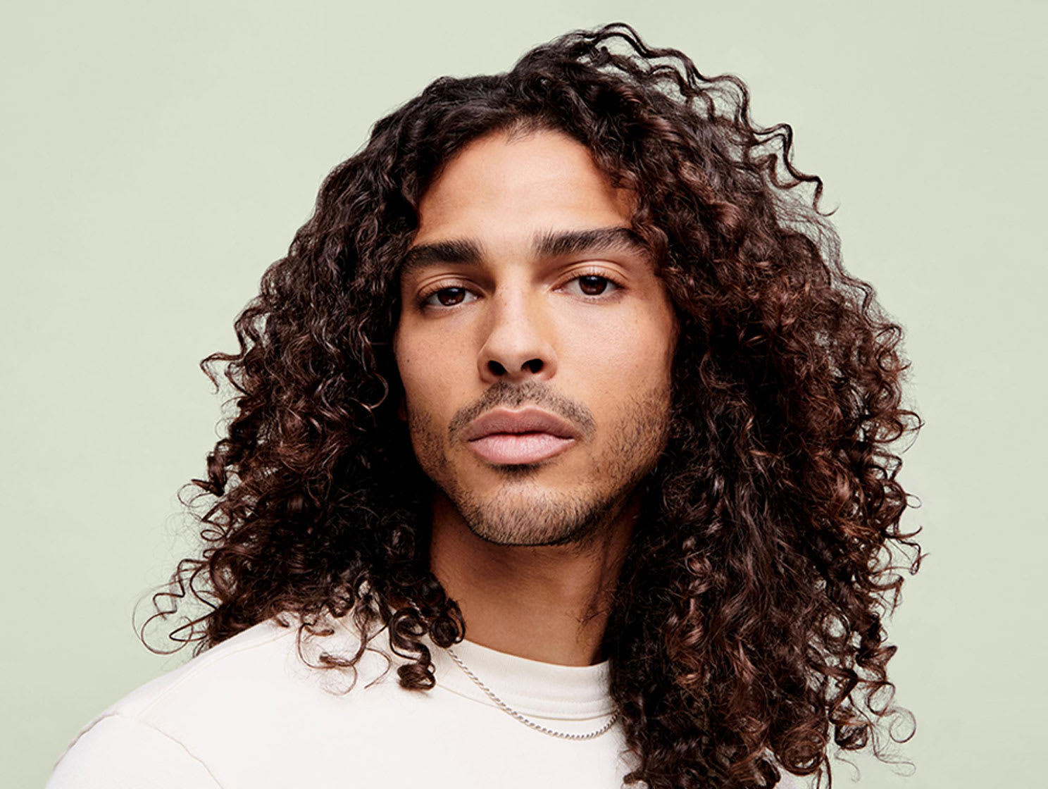 man with brown curly hair