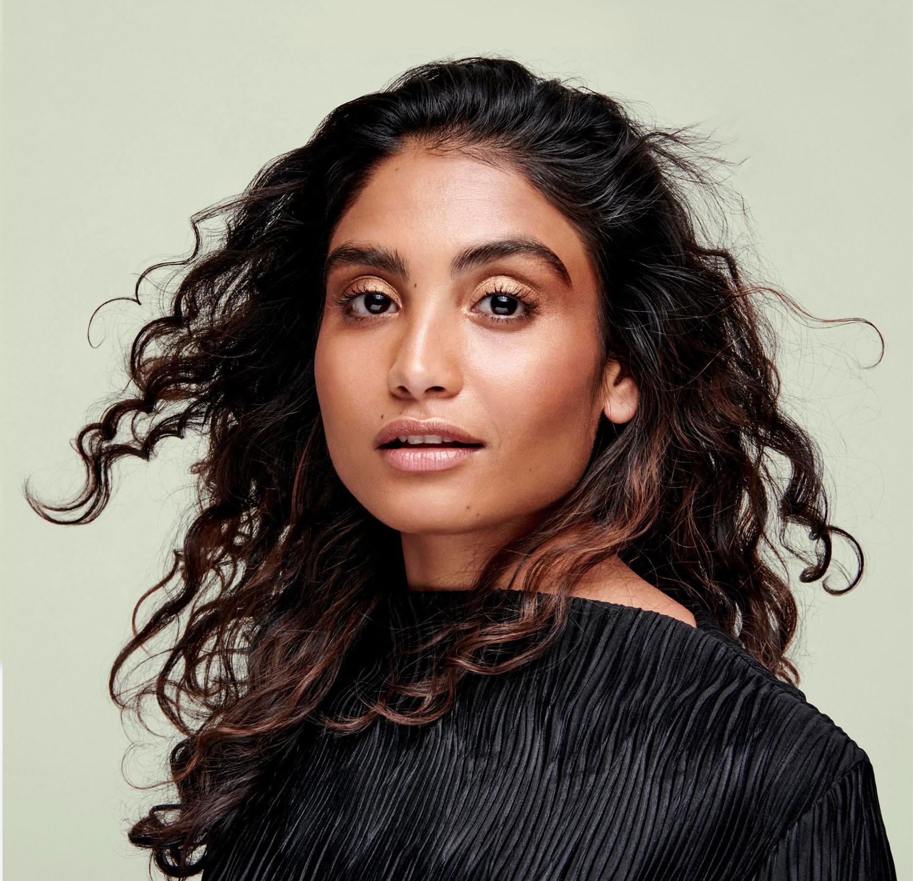woman with dark brown wavy hair