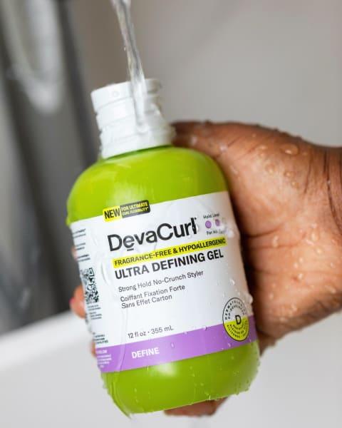 hand holding DevaCurl hypoallergenic hair gel bottle