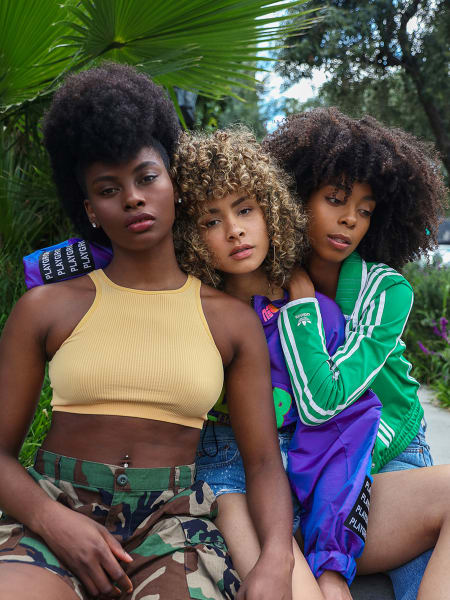 three curly hair women hanging out