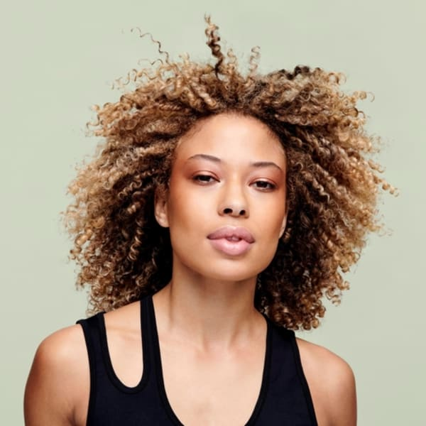 Woman with coily hair