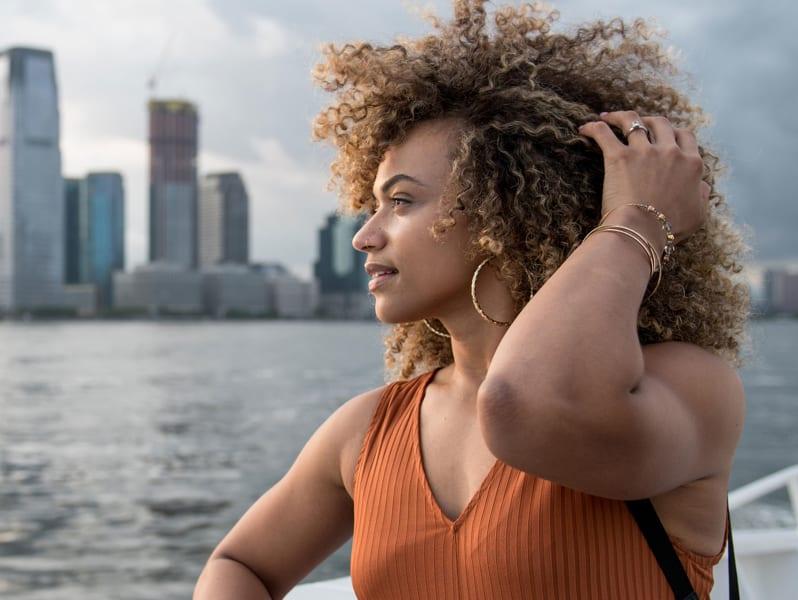 super curly hair woman touching hair