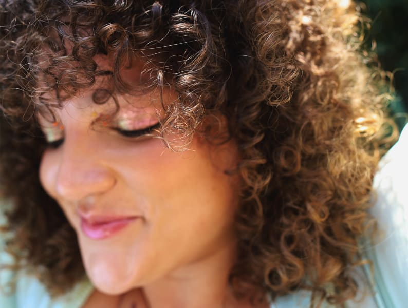 Close up of woman with curly hair