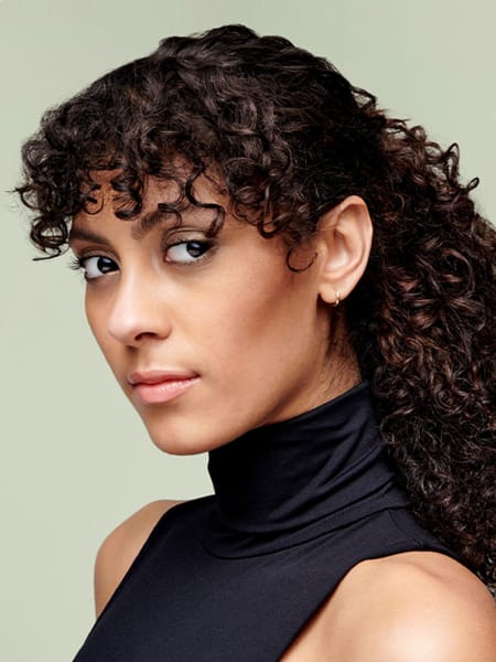 Woman with curls pulled back