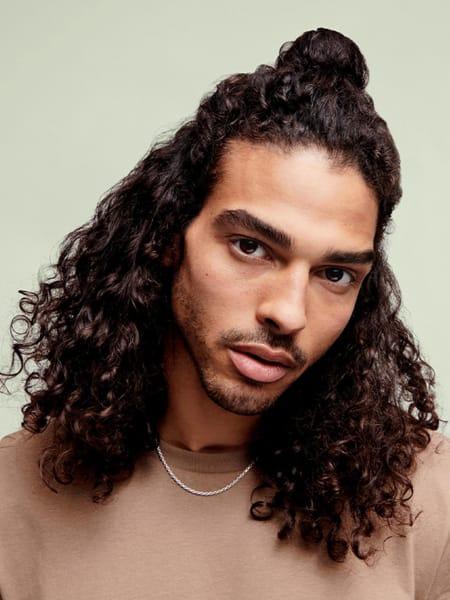 Male model with curls half up bun