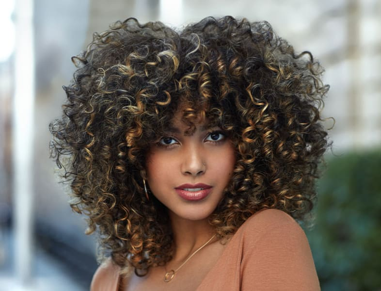 Woman with voluminous curly hair