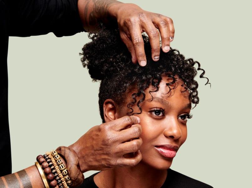 stylist hands in hair