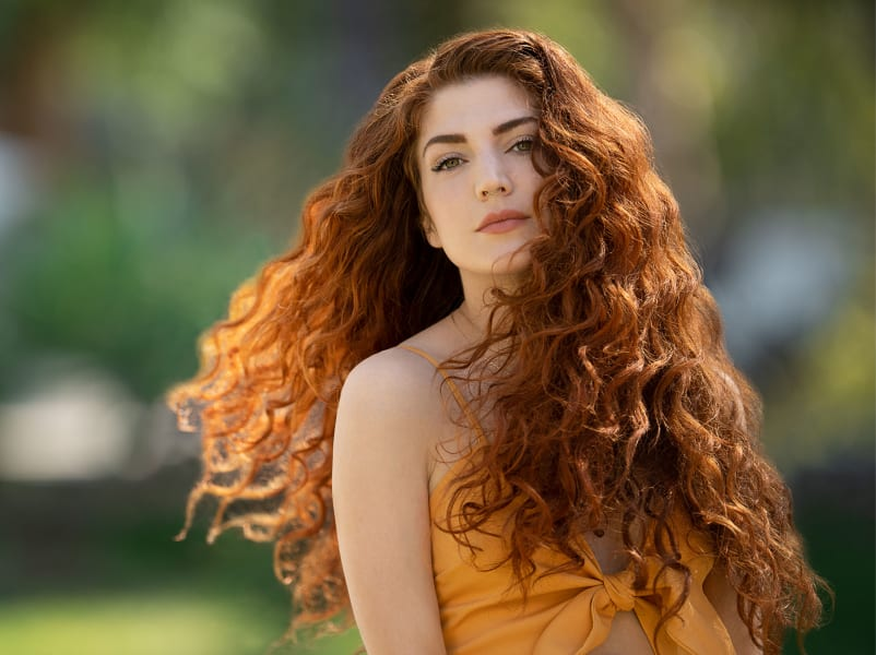 woman with long red wavy hair