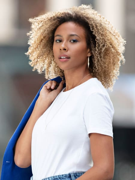 woman with blonde super curly hair