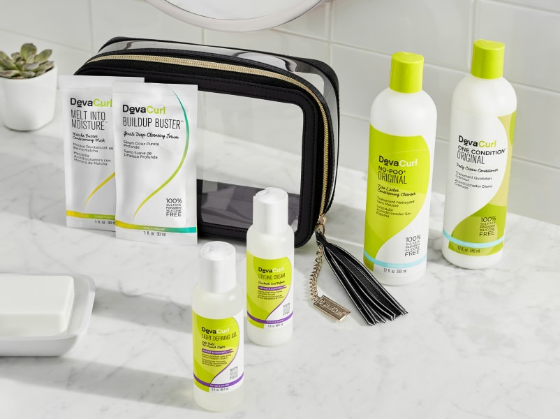devacurl black travel case with products outside