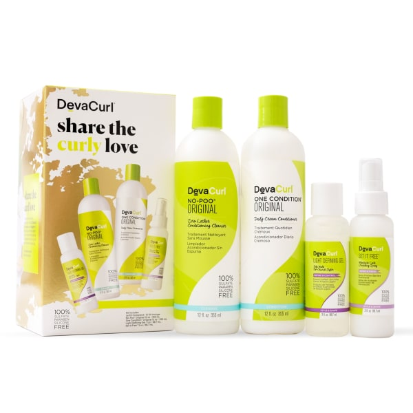 holiday kit with original cleanser and conditioner bottles outside of box