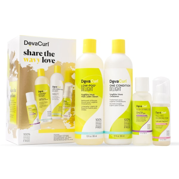 holiday kit with delight cleanser and conditioner bottles and stylers outside box