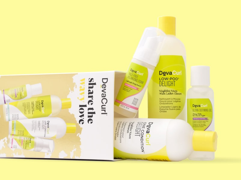 wavy DevaCurl share the wavy love holiday kit with bottles spilled out