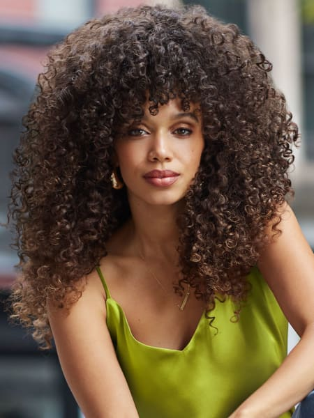 close-up of woman with voluminous super curly hair