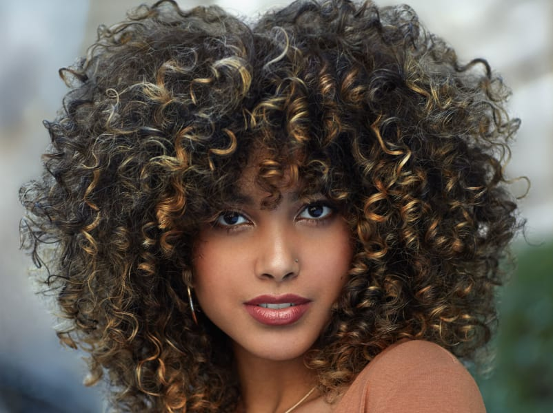 close-up of woman with voluminous curls